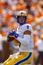 Pittsburgh quarterback Kenny Pickett (8) looks for a receiver during the first half of an NCAA college football game against Tennessee Saturday, Sept. 11, 2021, in Knoxville, Tenn. (AP Photo/Wade Payne)