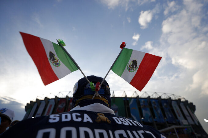 Mexican flags adorn a fan's hat before an NFL football game between the Los Angeles Chargers and the Kansas City Chiefs Monday, Nov. 18, 2019, in Mexico City. (AP Photo/Rebecca Blackwell)