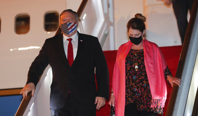 U.S. Secretary of State Mike Pompeo, and his wife Susan disembark from an aircraft upon their arrival at the airport in Colombo, Sri Lanka, Tuesday, Oct. 27, 2020. (AP Photo/Eranga Jayawardena, Pool)