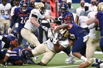 Army's Jakobi Buchanan, center, is brought down by UTSA's Jamal Ligon (88) during an NCAA college football game on Saturday, Oct. 17, 2020, in San Antonio, Texas. (AP Photo/Darren Abate)