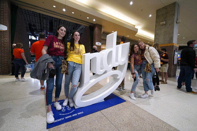 Fans take a photo at Bankers Life Fieldhouse before a Sweet 16 game between Loyola Chicago and Oregon State in the NCAA men's college basketball tournament at Bankers Life Fieldhouse, Saturday, March 27, 2021, in Indianapolis. (AP Photo/Darron Cummings)
