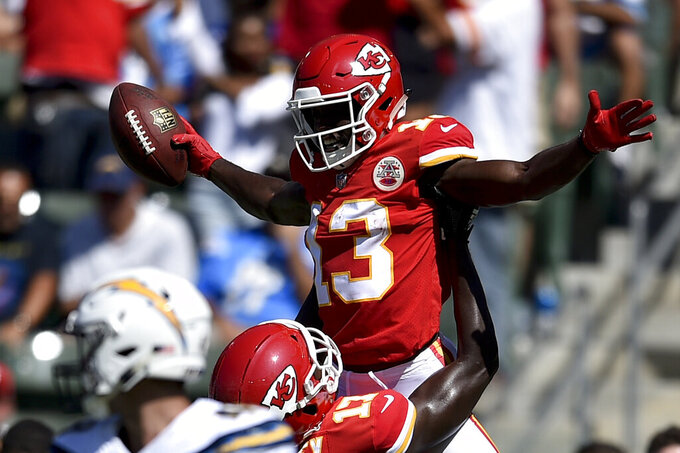 FILE - In this Sept. 9, 2018, file photo, Kansas City Chiefs wide receiver De'Anthony Thomas (13) celebrates after scoring with wide receiver Chris Conley during the second half of an NFL football game against the Los Angeles Chargers in Carson, Calif. The new faces that are on the Kansas City Chiefs' roster aren't exactly new. That would be offensive lineman Jeff Allen, who has been with the franchise most of his career, and wide receiver De'Anthony Thomas, who is coming off a knee injury. But their past experience in Kansas City means both could be on the field for a preseason game Saturday night, Aug. 24, 2019. (AP Photo/Kelvin Kuo, File)