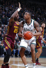 Michigan State's Nick Ward, right, looks to shoot against Minnesota's Daniel Oturu during the first half of an NCAA college basketball game, Saturday, Feb. 9, 2019, in East Lansing, Mich. (AP Photo/Al Goldis)