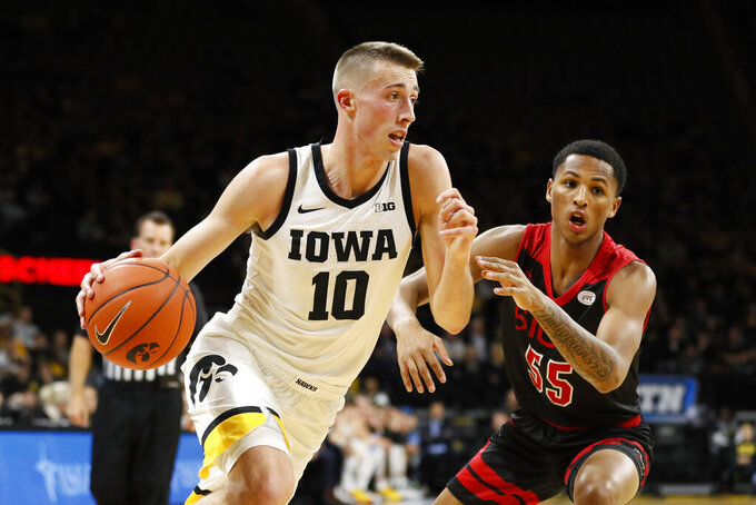 Iowa guard Joe Wieskamp (10) drives to the basket past SIU-Edwardsville forward Lamar Wright during the first half of an NCAA college basketball game, Friday, Nov. 8, 2019, in Iowa City, Iowa.(AP Photo/Charlie Neibergall)