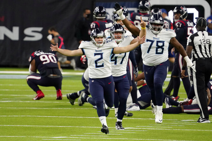 Tennessee Titans kicker Sam Sloman (2) celebrates after kicking the game-winning field goal against the Houston Texans during the second half of an NFL football game Sunday, Jan. 3, 2021, in Houston. (AP Photo/Sam Craft)