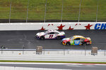 Denny Hamlin (11) and Kyle Busch (18) compete in a NASCAR Cup Series auto race at Charlotte Motor Speedway in Concord, N.C., Sunday, Oct. 11, 2020. (AP Photo/Nell Redmond)