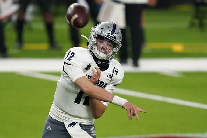 Nevada quarterback Carson Strong (12) throws against UNLV during the second half of an NCAA college football game Saturday, Oct. 31, 2020, in Las Vegas. (AP Photo/John Locher)