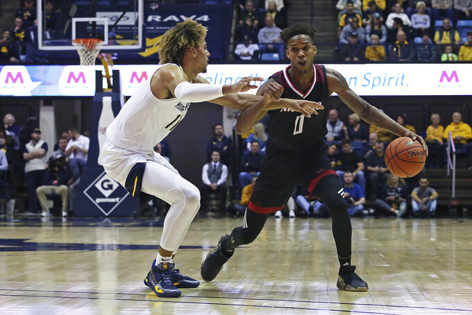 Nicholls State guard D'Angelo Hunter (0) is defended by West Virginia forward Emmitt Matthews Jr. (11) as he drives it up court during the first half of an NCAA college basketball game Saturday, Dec. 14, 2019, in Morgantown, W.Va. (AP Photo/Kathleen Batten)