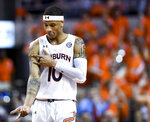 Auburn guard Samir Doughty celebrates a basket against Mississippi during the first half of an NCAA college basketball game Tuesday, Feb. 25, 2020, in Auburn, Ala. (AP Photo/Julie Bennett)
