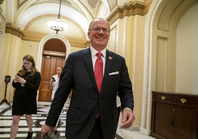 Rep. John Rose, R-Tenn., a freshman from Cookeville, Tenn., leaves the chamber at the Capitol after he blocked a unanimous consent vote during a scheduled pro forma House session on a long-awaited $19 billion disaster aid bill in the chamber, Thursday, May 30, 2019. Rep. Thomas Massie, R-Ky., and freshman Rep. Chip Roy, R-Texas, have both blocked passage of the measure in the past week. (AP Photo/J. Scott Applewhite)