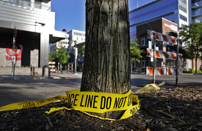 Discarded police tape lays outside a Target Monday, June 14, 2021, in Uptown Minneapolis.  Minneapolis police and witnesses say a woman was killed and multiple others were injured when an SUV struck a parked car and tossed it into demonstrators during a protest late Sunday in Minneapolis. (David Joles/Star Tribune via AP)