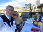 This July 3, 2020 image provided by Peter Batty shows him and his wife celebrating their anniversary and the opening night of the Santa Fe Opera on their balcony in Denver, Colo. The famed opera is offering a series of virtual performances after being forced to cancel the 2020 season due to the coronavirus pandemic. The Saturday night events are meant to celebrate the five originally-scheduled operas that would have been performed this summer. (Peter Batty via AP)