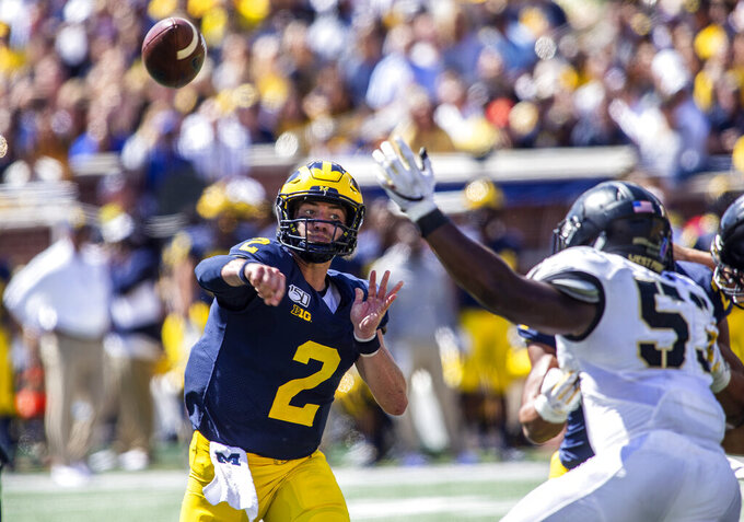 Michigan quarterback Shea Patterson (2) throws a pass in the second quarter of an NCAA football game against Army in Ann Arbor, Mich., Saturday, Sept. 7, 2019. (AP Photo/Tony Ding)