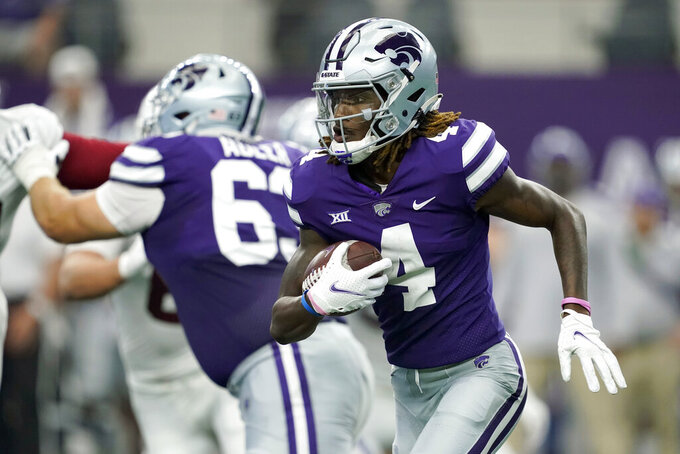 Kansas State wide receiver Malik Knowles (4) looks for running room in the first half of an NCAA college football game against Stanford in Arlington, Texas, Saturday, Sept. 4, 2021. (AP Photo/Tony Gutierrez)