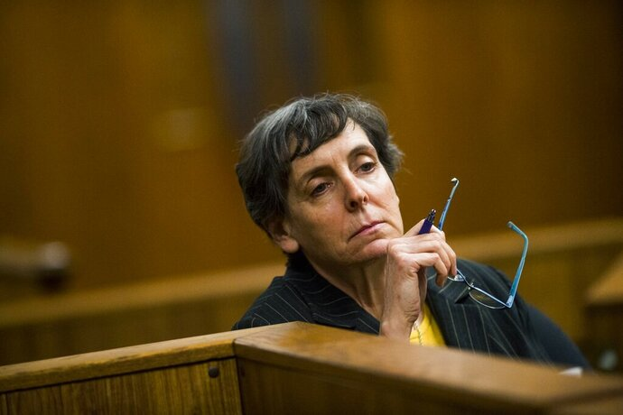 FILE- In a Feb. 5, 2018, file photo, defendant Liane Shekter-Smith, 57, listens during a preliminary examination in the cases of four defendants, all former or current officials from the Michigan Department of Environmental Quality in Flint, Mich. Shekter-Smith, Michael Prysby and Stephen Busch of the MDEQ recently accepted plea deals in the Flint water criminal investigation. Some Flint residents are upset, saying key people who could have stopped the lead disaster in 2014-15 are getting off easy. (Jake May/The Flint Journal via AP, File)