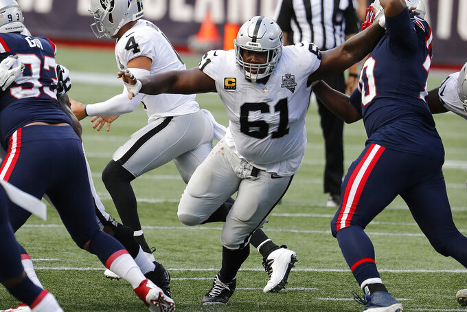 FILE - Las Vegas Raiders center Rodney Hudson blocks against the New England Patriots during an NFL football game at Gillette Stadium in Foxborough, Mass., in this Sunday, Sept. 27, 2020, file photo.  The Las Vegas Raiders are planning to release star center Rodney Hudson as part of a major overhaul of the team's offensive line. A person familiar with the move said Tuesday, March 16, 2021, that Hudson will be released with two years left on his current contract. The person spoke on condition of anonymity because the move hadn't been announced. NFL Network first reported the move.(AP Photo/Winslow Townson, File)