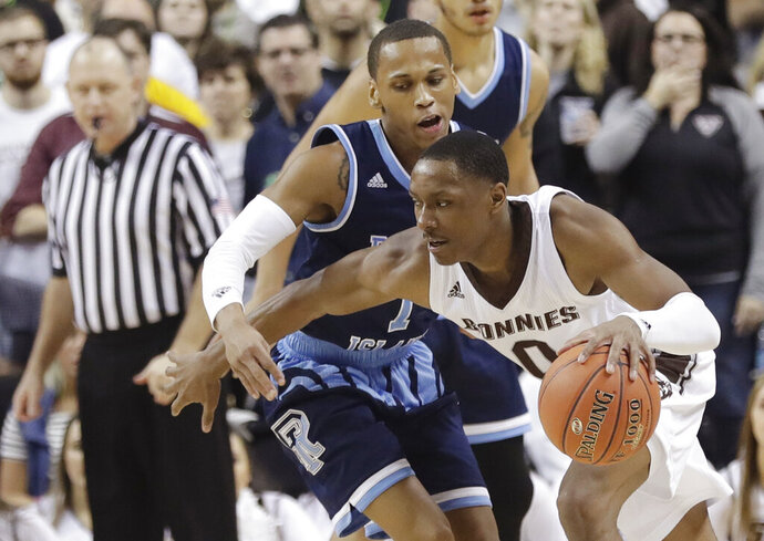 St. Bonaventure's Kyle Lofton (0) protects the ball from Rhode Island's Fatts Russell (1) during the second half of an NCAA college basketball game in the semifinal round of the Atlantic 10 men's tournament Saturday, March 16, 2019, in New York. St. Bonaventure won 68-51. (AP Photo)