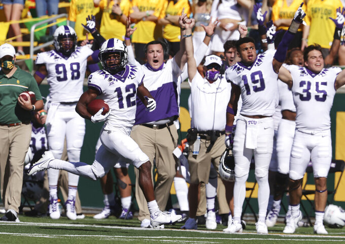 TCU wide receiver Derius Davis scores on a punt return over Baylor in the first half of an NCAA college football game, Saturday, Oct. 31, 2020, in Waco, Texas. (Rod Aydelott/Waco Tribune-Herald via AP)