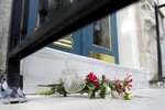 Flowers left by neighbor Mary Bianchi are seen on the doorstep to the home of U.S. Rep. Elijah Cummings, D-Md., Thursday, Oct. 17, 2019, in Baltimore. Cummings, a sharecropper's son who rose to become the powerful chairman of one of the U.S. House committees leading an impeachment inquiry of President Donald Trump, died Thursday, Oct. 17, 2019, of complications from longstanding health issues. He was 68. (AP Photo/Julio Cortez)