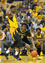 Vanderbilt's Saben Lee, right, dribbles around Missouri's Kevin Puryear, left, during the first half of an NCAA college basketball game Saturday, Feb. 2, 2019, in Columbia, Mo. (AP Photo/L.G. Patterson)