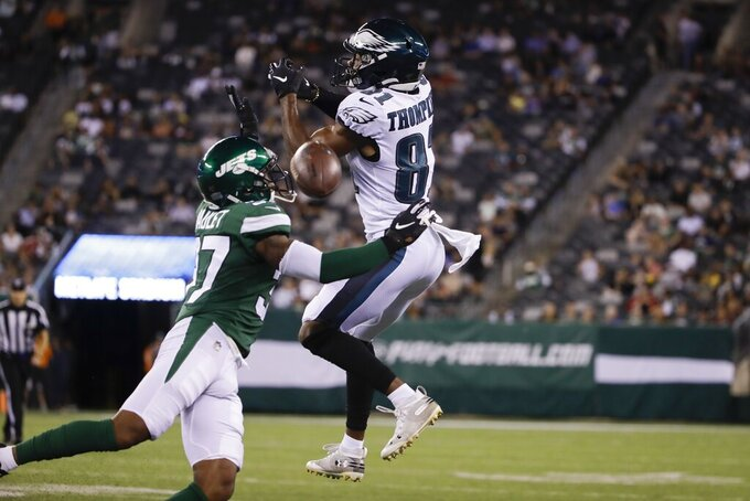 New York Jets' Arthur Maulet (37) breaks up a pass to Philadelphia Eagles' DeAndre Thompkins (81) during the second half of a preseason NFL football game Thursday, Aug. 29, 2019, in East Rutherford, N.J. (AP Photo/Matt Rourke)