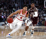 Mississippi guard Breein Tyree (4) dribbles past Mississippi State guard Nick Weatherspoon (0) in the second half of an NCAA college basketball game, Saturday, Jan. 12, 2019 in Starkville, Miss. Mississippi won 81-77. (AP Photo/Rogelio V. Solis)