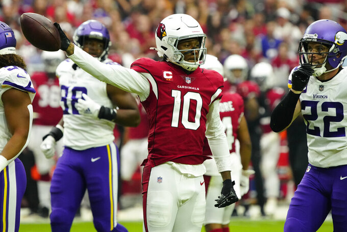 Arizona Cardinals wide receiver DeAndre Hopkins (10) signals first down after his catch against the Minnesota Vikings during the first half of an NFL football game, Sunday, Sept. 19, 2021, in Glendale, Ariz. (AP Photo/Rick Scuteri)