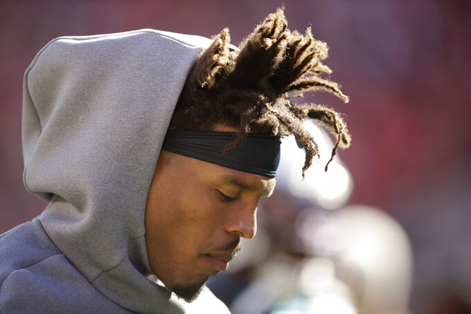 Carolina Panthers quarterback Cam Newton stands on the sidelines during the first half of an NFL football game against the San Francisco 49ers in Santa Clara, Calif., Sunday, Oct. 27, 2019. (AP Photo/Ben Margot)