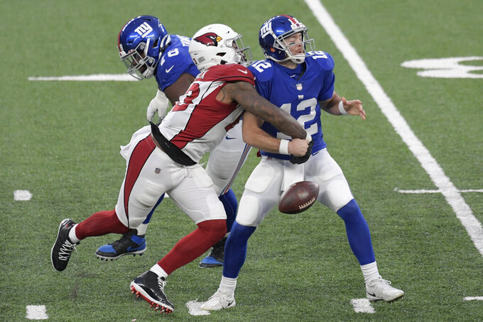 Arizona Cardinals' Haason Reddick, left, knocks the ball out of New York Giants quarterback Colt McCoy's hands during the second half of an NFL football game, Sunday, Dec. 13, 2020, in East Rutherford, N.J. (AP Photo/Bill Kostroun)