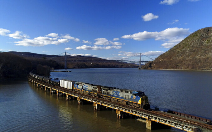 FILE- In this April 26, 2018, file photo, a CSX Transportation locomotive pulls a train of tank cars across a bridge on the Hudson River along the edge of Bear Mountain State Park near Fort Montgomery, N.Y. CSX railroad's second-quarter profit more than doubled as the economy continued to rebound from the depths of the coronavirus pandemic, the company announced Wednesday, July 21, 2021. (AP Photo/Julie Jacobson, File)