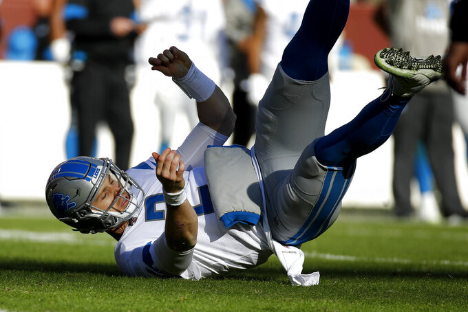 Detroit Lions quarterback Jeff Driskel falls back after being pushed by Washington Redskins outside linebacker Ryan Kerrigan, not visible, during the first half of an NFL football game, Sunday, Nov. 24, 2019, in Landover, Md. (AP Photo/Patrick Semansky)