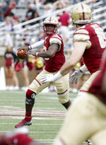FILE - In this Sept. 8, 2018, file photo, Boston College quarterback Anthony Brown (13) scrambles as he looks to pass during the first half of an NCAA college football game against Holy Cross, in Boston. Check out the FBS passing leaders and it is Brown who is No. 1.(AP Photo/Mary Schwalm, File)