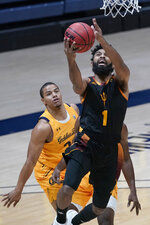 Arizona State guard Remy Martin (1) shoots in front of California's Matt Bradley during the first half of an NCAA college basketball game in Berkeley, Calif., Thursday, Dec. 3, 2020. (AP Photo/Jeff Chiu)