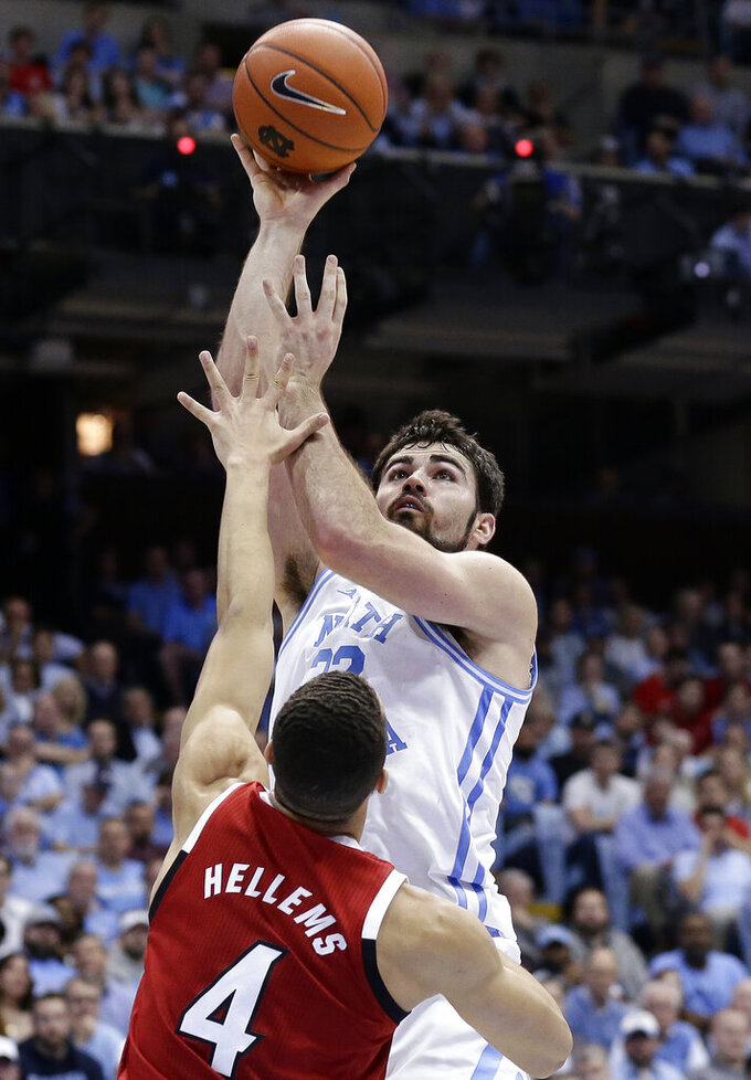 North Carolina's Luke Maye shoots over North Carolina State's Jericole Hellems (4) during the first half of an NCAA college basketball game in Chapel Hill, N.C., Tuesday, Feb. 5, 2019. (AP Photo/Gerry Broome)