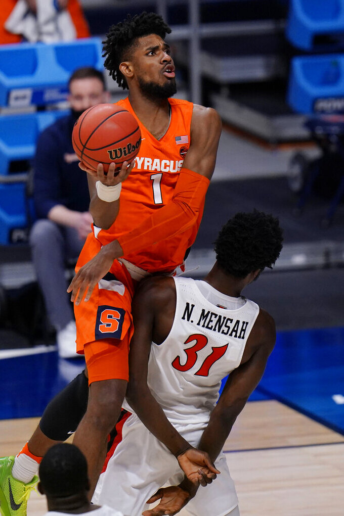 Syracuse forward Quincy Guerrier (1) commits an offensive foul on San Diego State forward Nathan Mensah (31) during the second half of a college basketball game in the first round of the NCAA men's tournament at Hinkle Fieldhouse in Indianapolis, Friday, March 19, 2021. Syracuse won 78-62. (AP Photo/AJ Mast)