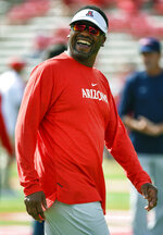 Arizona head coach Kevin Sumlin smiles during warmups before an NCAA college football game against Houston, Saturday, Sept. 8, 2018, in Houston. (AP Photo/Eric Christian Smith)