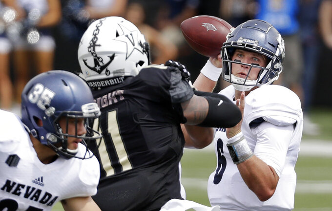 Nevada quarterback Ty Gangi (6) passes as he is pressured by Vanderbilt linebacker Charles Wright (11) in the first half of an NCAA college football game Saturday, Sept. 8, 2018, in Nashville, Tenn. (AP Photo/Mark Humphrey)