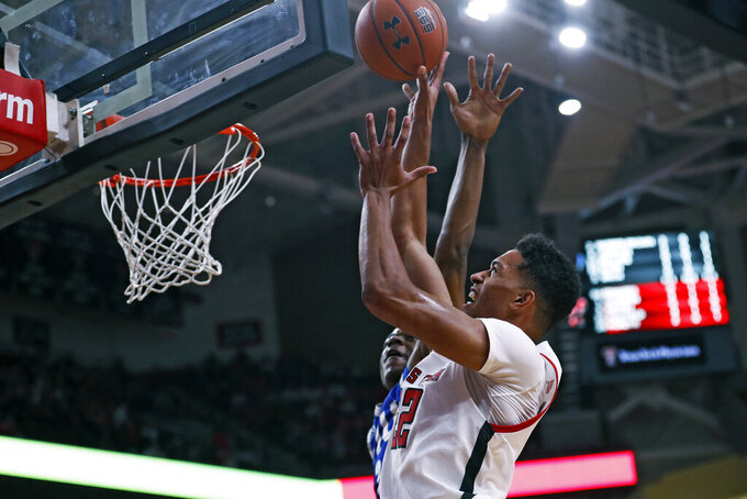 Texas Tech's TJ Holyfield (22) shoots the ball over Eastern Illinois' Jordan Skipper-Brown (2) during the first half of an NCAA college basketball game Tuesday, Nov. 5, 2019, in Lubbock, Texas. (AP Photo/Brad Tollefson)