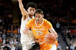 Tennessee guard Santiago Vescovi (25) drives against Vanderbilt guard Scotty Pippen Jr. during the first half of an NCAA college basketball game Saturday, Jan. 18, 2020, in Nashville, Tenn. (AP Photo/Mark Humphrey)