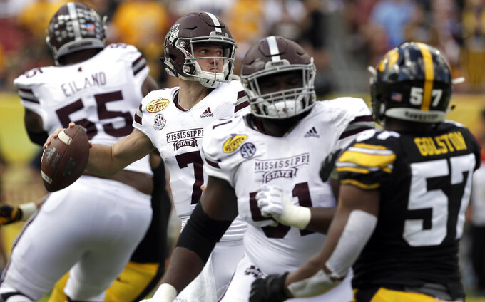 Mississippi State quarterback Nick Fitzgerald (7) fires a pass against Iowa during the first half of the Outback Bowl NCAA college football game, Tuesday, Jan. 1, 2019, in Tampa, Fla. (AP Photo/Chris O'Meara)