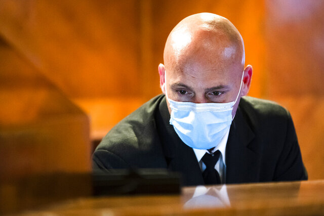 Concierge Joe DeLuca, poses for a photograph at the front desk of an apartment building in New York, April 6, 2020. While tens of thousands of New Yorkers work at home during the COVID-19 pandemic, people like DeLuca keep the city running amid the lockdown. (AP Photo/Matt Rourke)