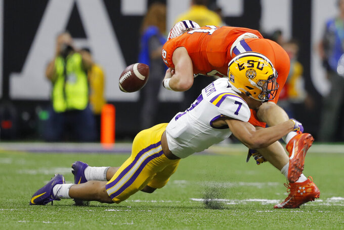 LSU safety Grant Delpit forces a fumble by Clemson quarterback Trevor Lawrence during the second half of a NCAA College Football Playoff national championship game Monday, Jan. 13, 2020, in New Orleans. (AP Photo/Gerald Herbert)