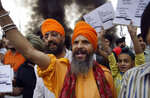 FILE - In this May 8, 2009, file photo, Sikh activists shout slogans against the Taliban and Pakistan to protest Taliban atrocities against Sikhs in Pakistan's northwest region in Jammu, India. India's leaders are anxiously watching the Taliban takeover in Afghanistan, fearing that it will benefit their bitter rival Pakistan and feed a long-simmering insurgency in the disputed region of Kashmir, where militants already have a foothold. (AP Photo/Channi Anand, File)