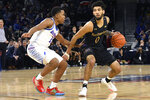 Northwestern guard Boo Buie (0) works against DePaul guard Charlie Moore (11) during the first half of an NCAA college basketball game, Saturday, Dec. 21, 2019, in Chicago. (AP Photo/David Banks)