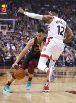 Cleveland Cavaliers' Dante Exum (1) is defended by Toronto Raptors' Oshae Brissett (12) during the first half of an NBA basketball game Tuesday, Dec. 31, 2019, in Toronto. (Hans Deryk/The Canadian Press via AP)