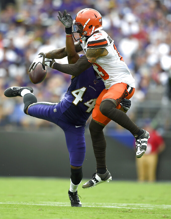 Baltimore Ravens cornerback Marlon Humphrey (44) disrupts a pass intended for Cleveland Browns wide receiver Odell Beckham (13) during the second half of an NFL football game Sunday, Sept. 29, 2019, in Baltimore. (AP Photo/Gail Burton)