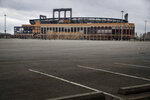 FILE - This March 25, 2020 file photo shows the empty parking lot surrounding Citifield, the home of the New York Mets, in the Queens borough of New York. The Yankees and Mets would train in New York if Major League Baseball and its players try to start the coronavirus-delayed season. New York Gov. Andrew Cuomo made the announcement Saturday, June 20, 2020, and the teams confirmed the decisions. (AP Photo/John Minchillo)