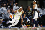 Dallas Wings guard Arike Ogunbowale (24) drives to the basket against Chicago Sky guard Kahleah Copper (2) during the first half in the first round of the WNBA basketball playoffs, Thursday, Sept. 23, 2021, in Chicago. (AP Photo/Kamil Krzaczynski)