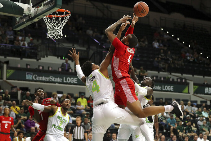 South Florida's Michael Durr blocks a shot attempt from Houston's Justin Gorham during the first half of an NCAA college basketball game Wednesday, Feb. 12, 2020, in Tampa, Fla. (AP Photo/Mike Carlson)