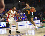 Baylor guard MaCio Teague (31) dribbles past Florida guard Noah Locke (10) during the second half of an NCAA college basketball game Saturday, Jan. 25, 2020, in Gainesville, Fla. (AP Photo/Matt Stamey)